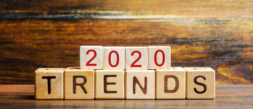 Wooden blocks with the word Trends 2020. Main trend of changing something. Popular and relevant topics. New ideological trends of fashion. Recent and latest trend. Evaluation methods. Fashionable