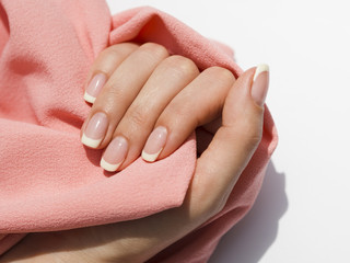 Foto auf Leinwand Maniküre Delicate woman hand holding soft fabric