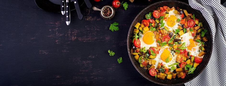 Late breakfast - fried eggs with vegetables. Shakshuka. Arabic cuisine. Kosher food. Banner. Top view