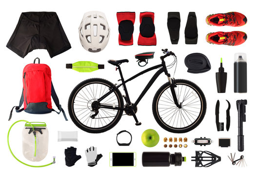 Flat lay of bicycle equipment and accessories isolated on white background. Top view of bike clothes and gear