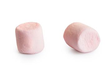 Two pink mini marshmallows isolated on white.