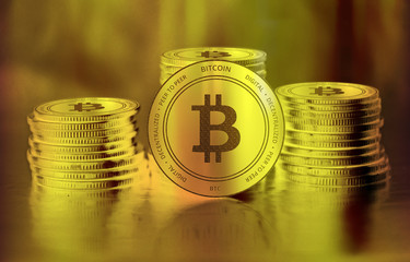 Bitcoin (BTC) digital crypto currency. Stack of golden coins. Cyber money.
