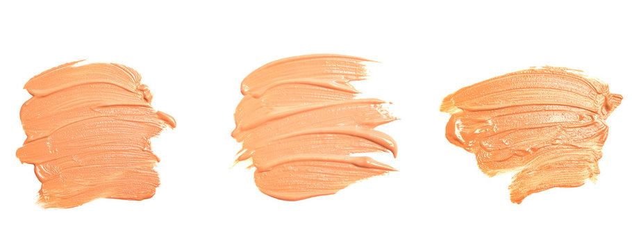 Set of make-up foundation smudges isolated on white