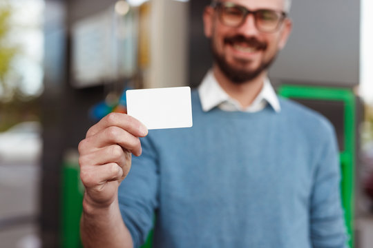 Happy client demonstrating blank card