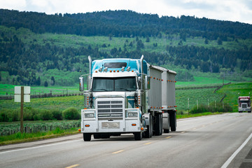 18 wheeler semi truck delivering cargo on the road