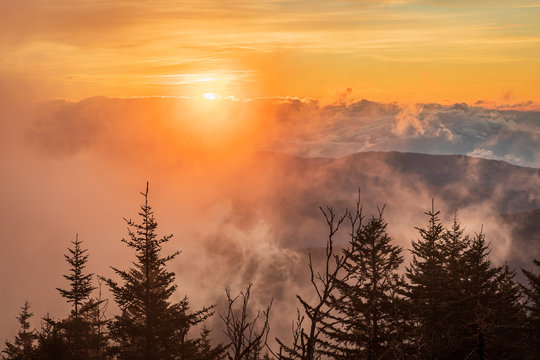 Sunrise with Solar halo and fog at Clingmans Dome of Great Smoky Mountains National Park, NC USA in autumn