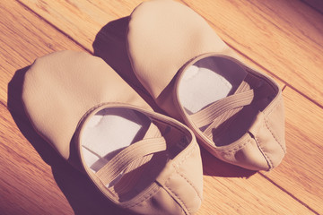 Closeup of a pair of dance shoes, ballet pointe shoes, and character shoes representing of dance classes in one image.  - Image