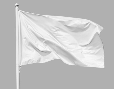 White flag waving in the wind on flagpole, isolated on gray background, closeup