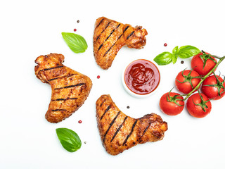Fototapete - grilled chicken wings, red bbq sauce tomatoes basil spices on white background