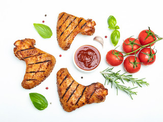 Fototapete - grilled chicken wings, red bbq sauce tomatoes basil rosemary spices on white background