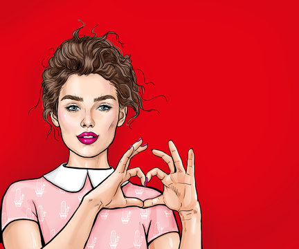 Beautiful young woman making heart with her hands on red background. Positive human emotion expression feeling life body language.Love