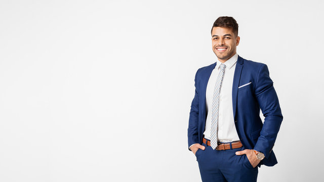Friendly Businessman Smiling On White Studio Background, Copy Space