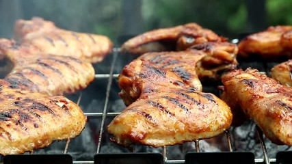 Fototapete - chicken wings grill, which are being grilled on barbecue