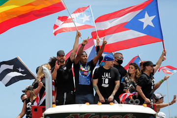 Puerto Rican celebrities including Residente, Bad Bunny and Ricky Martin join demonstrators during a protest calling for the resignation of Governor Ricardo Rossello in San Juan