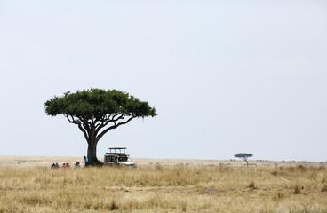 Tourist enjoying Lunch after doing safari at Masai Mara