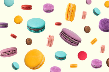 Falling macaroons  on light yellow background. Seamless texture or pattern