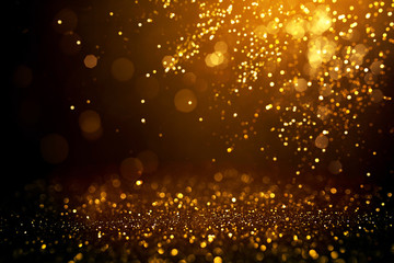 Golden abstract bokeh on black background. Wall mural