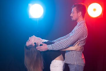 Social dance, kizomba, salsa, semba or zouk concept - a young couple dancing bachata and salsa at...