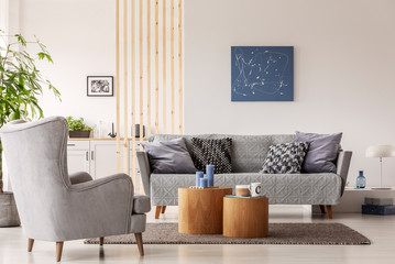 Natural scandinavian living room interior with wooden furniture, mockup picture on empty white wall Wall mural