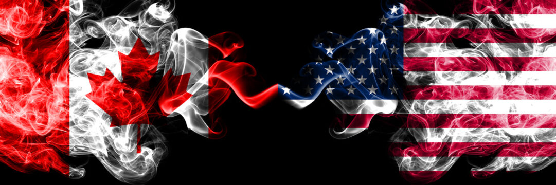 Canada vs United States of America, American smoky mystic flags placed side by side. Thick colored silky smoke flags of Canadian and United States of America, American.