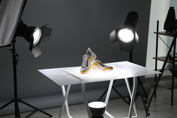 Fototapeta Professional photography equipment prepared for shooting stylish shoes in studio obraz