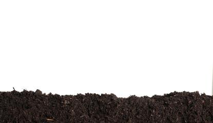 Fototapeta Layer of fresh soil isolated on white. Gardening time obraz