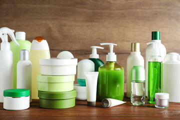 Wall Mural - Different body care products on table against wooden background