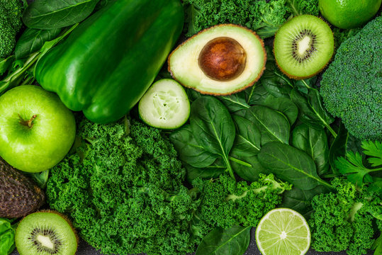Selection of healthy green food fresh vegetables and fruit. Concept of green color, clean eating, vegetarian and vegan food and cuisine, lifestyle, diet, and fitness