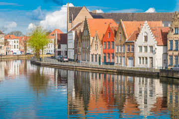 Wall Mural - Medieval buildings along a canal in Bruges, Belgium