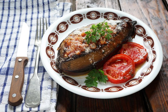 baked stuffed eggplant with tomatoes and Parmesan cheese