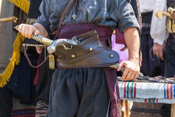 Haidutin belt with gun and sabre