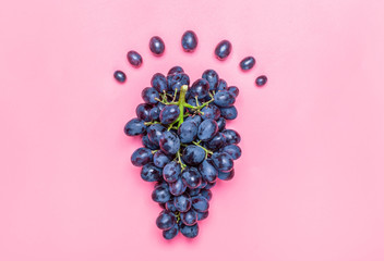 Natural organic black juicy grapes on a trend pink background Top View Flat Lay. Rustic Style. Country Village Agriculture concept