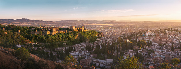 Panoramic view of Granada city with Alhambra at sunset - Granada, Andalusia, Spain