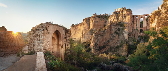 Panoramic view of Ronda Puente Nuevo Bridge at sunset - Ronda, Malaga Province, Andalusia, Spain Wall mural