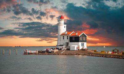 Obraz Lighthouse in the Dutch old village - fototapety do salonu
