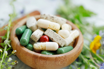 Natural suplements pills, alternative medicine with herbal plants extracts pills