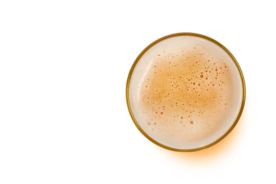 top view of beer bubbles in glass cup isolated on white background. copy space for design.