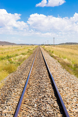 Papiers peints Voies ferrées railway track in countryside rural farmland area of South Africa