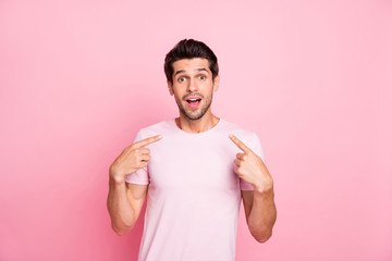 Portrait of his he nice attractive cheerful cheery glad shocked guy presenting surprise gift promotion him self isolated over pink pastel background