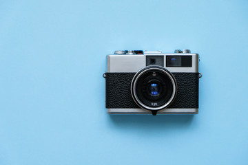 Fashion Film Camera on blue background.  Photo shooting. Pop Art. Hipster Trendy Vintage Accessories. Minimal flat lay