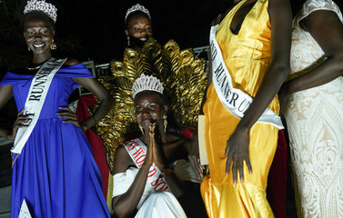 The winner of Miss World South Sudan, 22-year-old Mariah Nyayeina  poses for a photograph with other contestants during the Miss World South Sudan beauty pageant in Juba