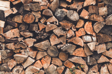 Stacked wooden logs, chopped firewood