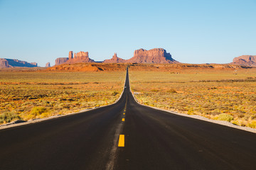 Wall Mural - Classic highway view in Monument Valley at sunset, USA