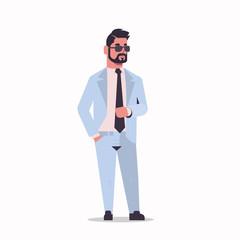 Wall Mural - arabic businessman in sunglasses standing pose arab bearded business man wearing elegant suit arabian male cartoon character full length flat white background