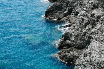 Wall Mural - Sea rock coast. Blue water wave at Cinque Terre, Liguria