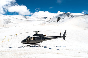 Helicopter on snowy landscape