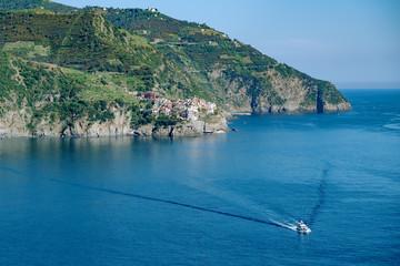 Wall Mural - Sea rock coast, view from Corniglia, Italy. Blue water wave at Cinque Terre, Liguria