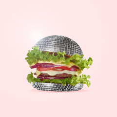 Food as fast as a disco dance. A burger as an discoball with salad, potato and meat. Negative space...