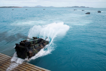 U.S. Marines assault amphibious vehicles, depart the well deck of the amphibious transport dock ship USS Green Bay  in Bowen Australia