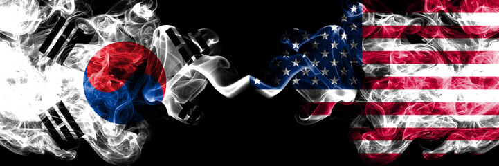 South Korea vs United States of America, American smoky mystic flags placed side by side. Thick colored silky abstract smoke flags of South Korean and United States of America, American